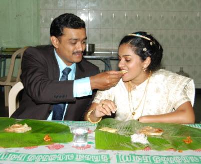 Groom feeding his new bride